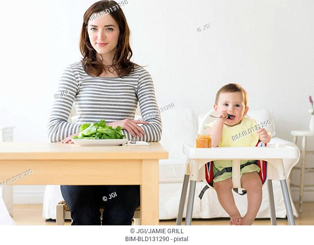 Mother and baby eating together