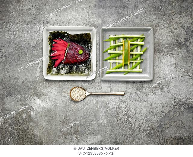 Ginger and smoked salmon coloured with beetroot juice, nori leaves and cucumber sticks