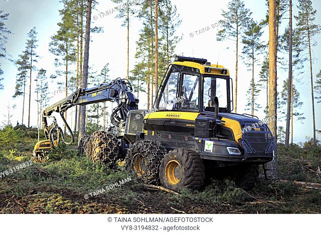 Salo, Finland - November 18, 2018: Logging site in Finnish pine forest on a day of autumn with Ponsse Ergo forest harvester. Filters applied