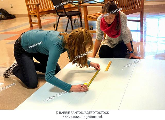 Teenage Girls Working on Project, Wellsville, New York, United States