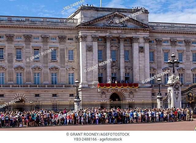 The British Royal Family On The Balcony Of Buckingham Palace Along With Thousands Of Tourists Wait For The Fly-Past to Commemorate The 70th Anniversary Of The...