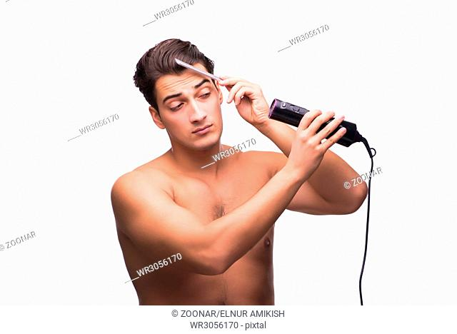 Young handsome drying his hair isolated on white
