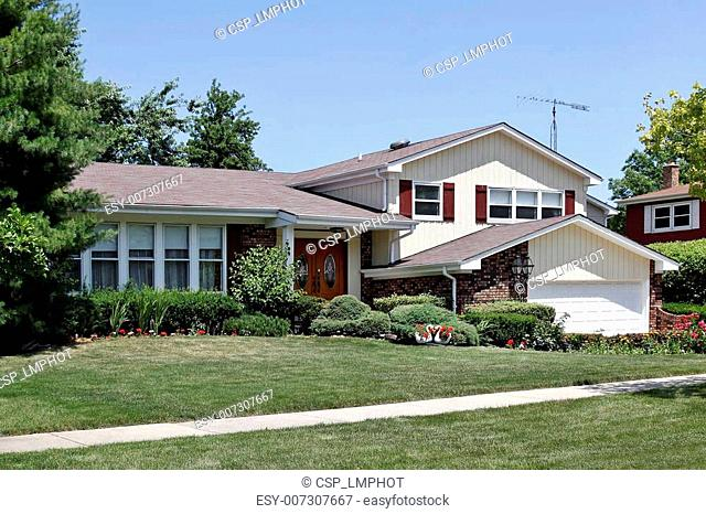 Brick home with red shutters