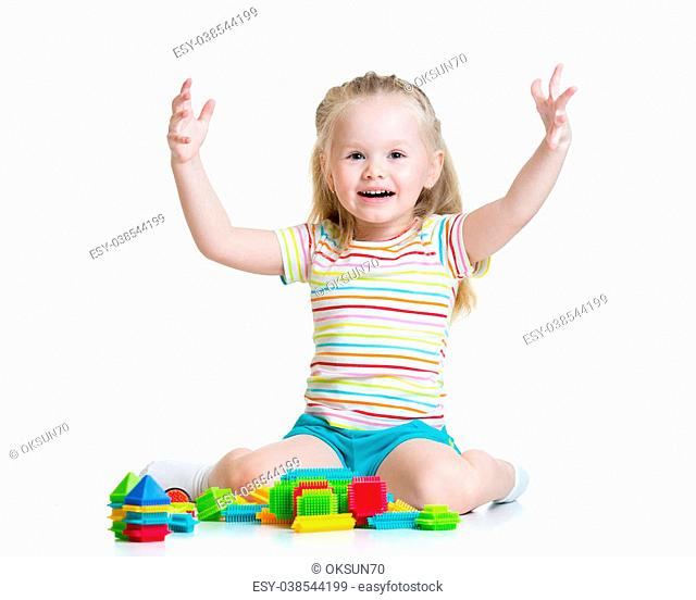 kid girl 3 years old playing toys isolated on white