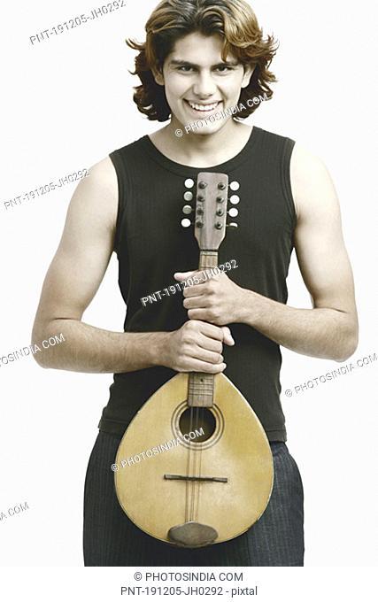 Portrait of a male musician holding a banjo