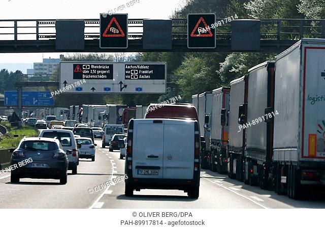 Cars are stuck in a traffic jam on the motorway A1 in front of the Leverkusen Rhine river bridge near Wermelskirchen, Germany, 10 April 2017