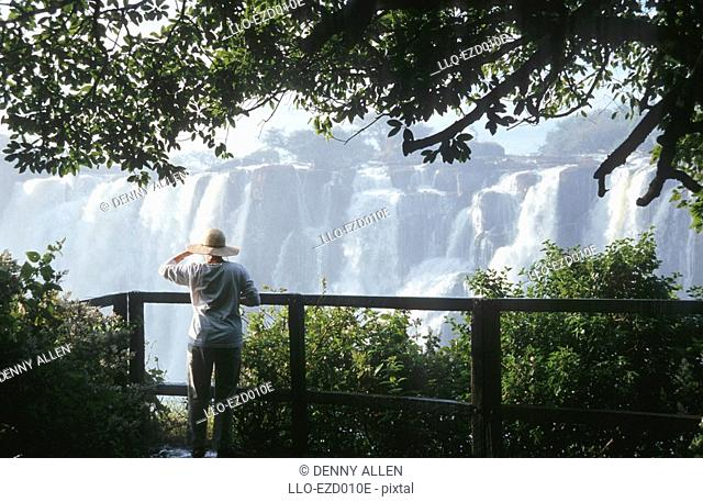 Woman at Lookout Over Victoria Falls  Zambezi River, Zambia