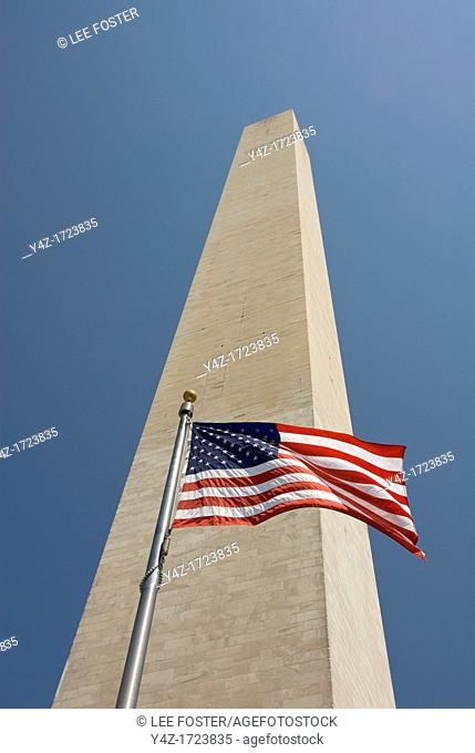 Washington DC USA: The Washington Monument and an American flag