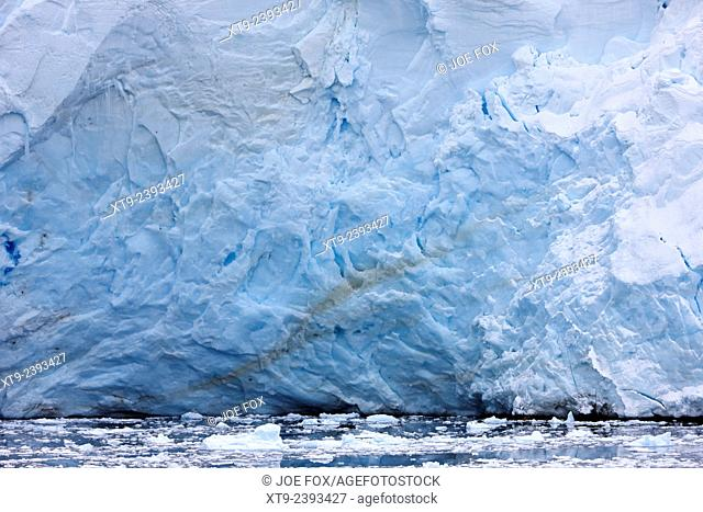 blue ice glacier face in the lemaire channel Antarctica