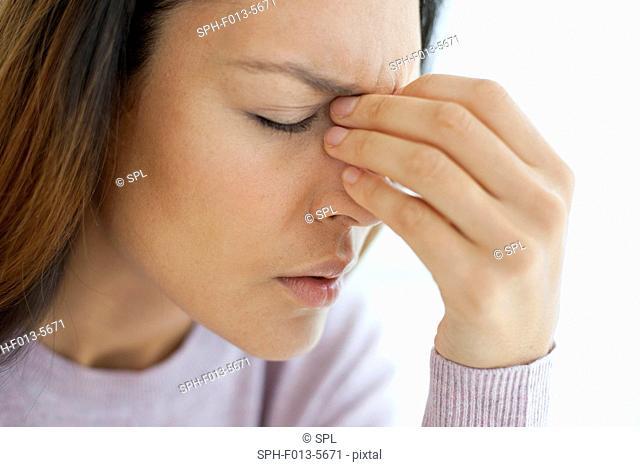 MODEL RELEASED. Young woman feeling unwell