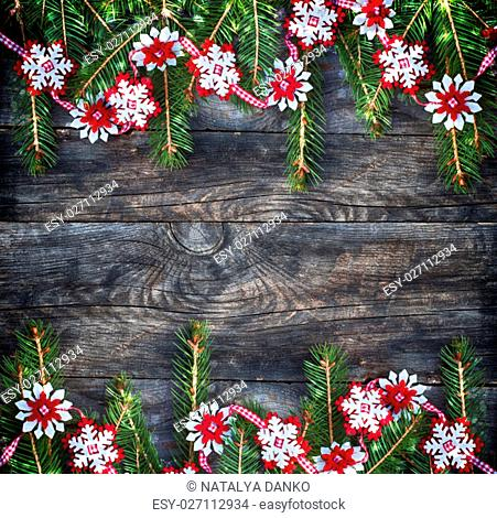 New Year and Christmas background with branch fir, empty space in the middle, vintage toning