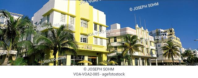 This is the art deco district of South Beach Miami. The buildings are painted in pastel colors surrounded by tropical palm trees