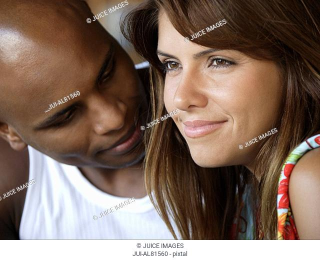 Man looking at woman and smiling