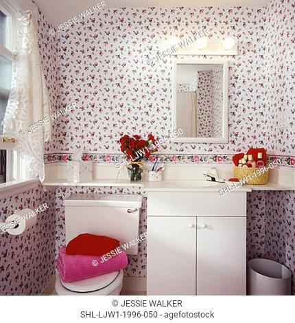 BATHROOMS: Small bathroom with rose patterned wallpaper. Cut lace curtain