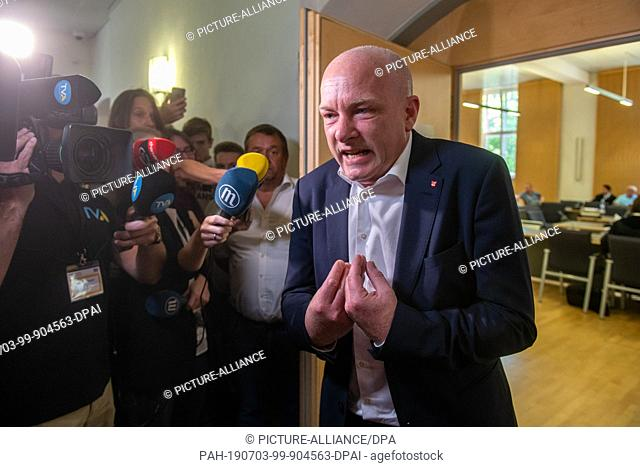 03 July 2019, Bavaria, Regensburg: Joachim Wolbergs, suspended Lord Mayor of Regensburg, speaks to journalists in front of the courtroom of the Regional Court