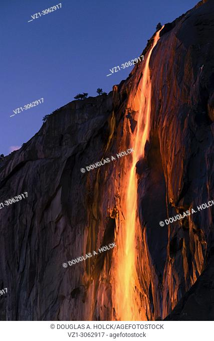 February setting sun reflects off Yosemite's seasonal Horsetail Fall, giving a molten lava appearance