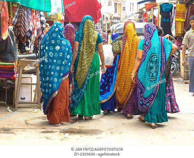 group of women in colorful saris at street in Bhuj, Gujarat, India