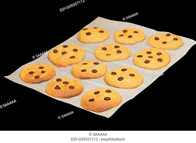 pumpkin cookies just after oven with chocolate on black background