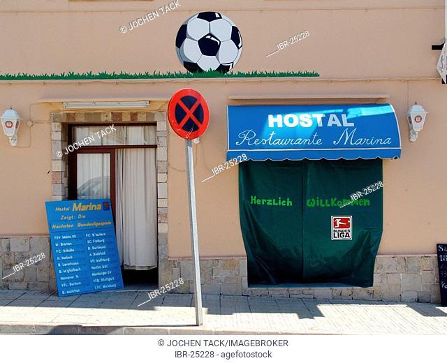 ESP, Spain, Balearic Islands, Mallorca, Cala Rajada : Pup shows german soccer on TV