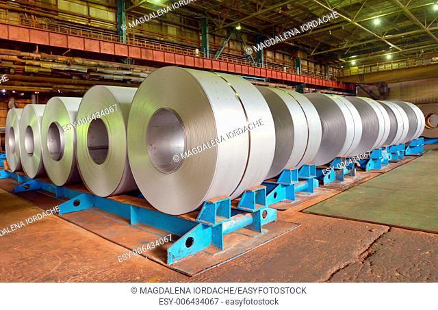 rolls of steel sheet in a factory