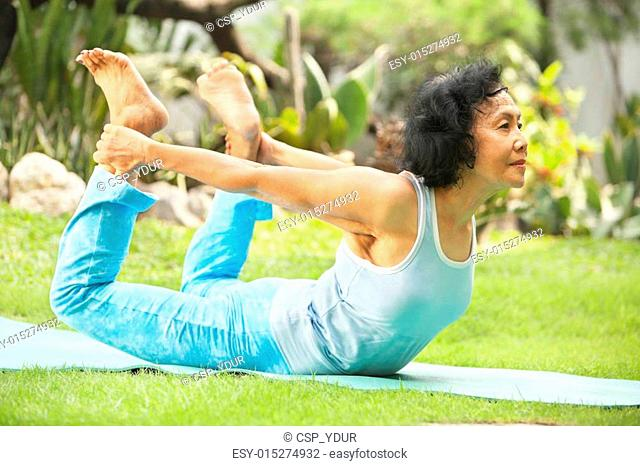 Asian senior old woman doing yoga