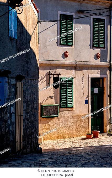 Sunny corner of empty cobblestone street, Rovinj, Croatia