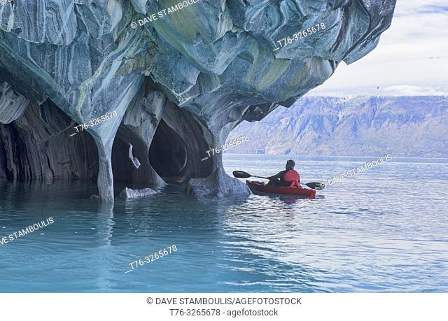 Kayaker exploring the surreal Marble Caves (Capilla de Mármol), Rio Tranquilo, Aysen, Patagonia, Chile