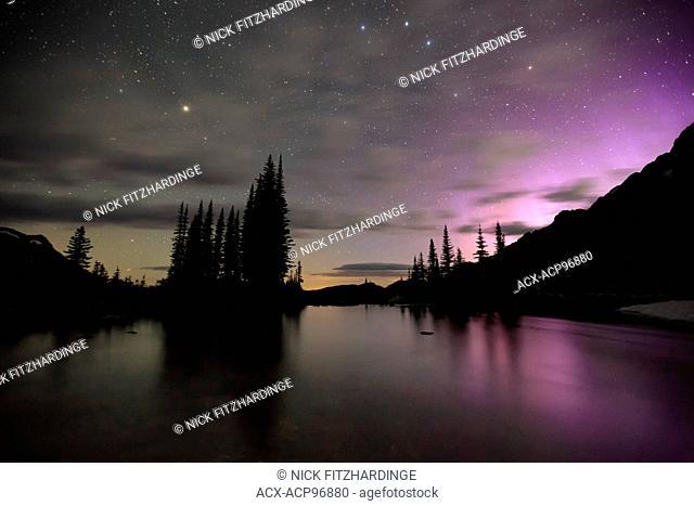 Monashee Lake and aurora borealis, Monashee Mountains, British Columbia, Canada