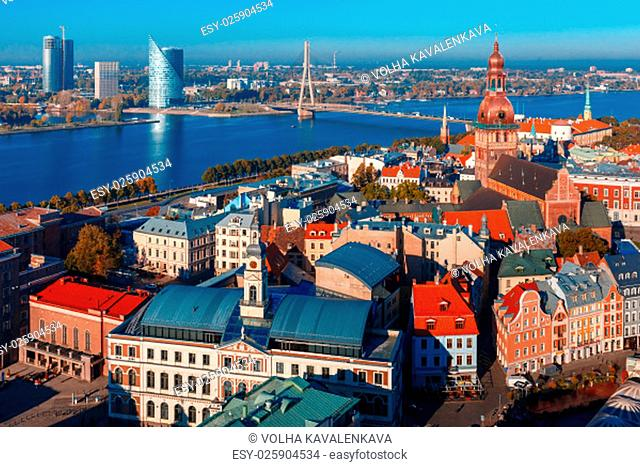 Aerial view of Old Town, skycrapers and River Daugava from Saint Peter church, with Riga Cathedral, Cathedral Basilica of Saint James and Riga castle, Riga