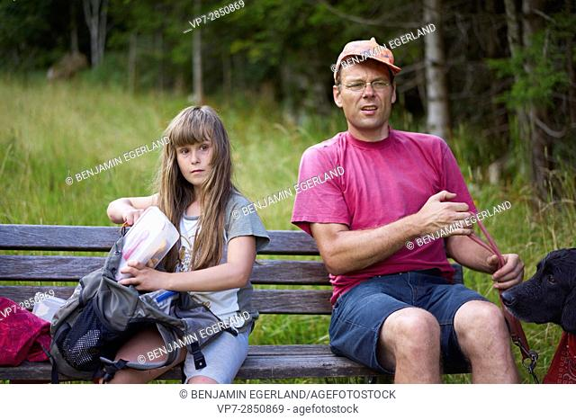 Young girl with her father during hiking adventure