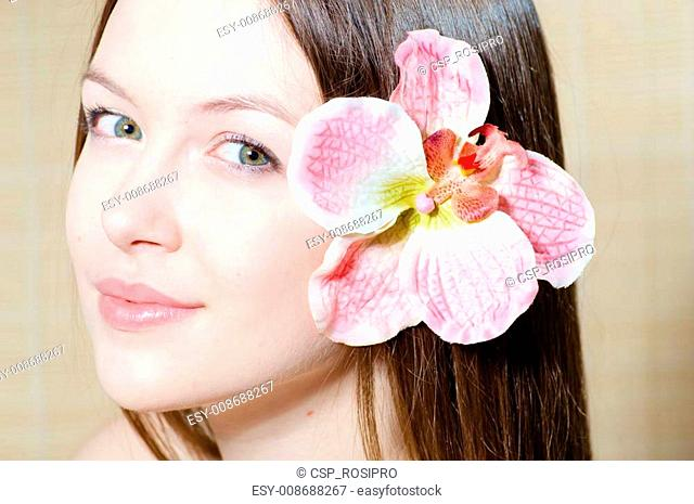 beautiful girl face & flower. Perfect skin
