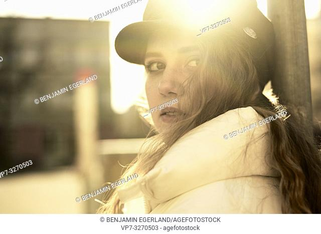 young woman in sunlight, in city Cottbus, Brandenburg, Germany
