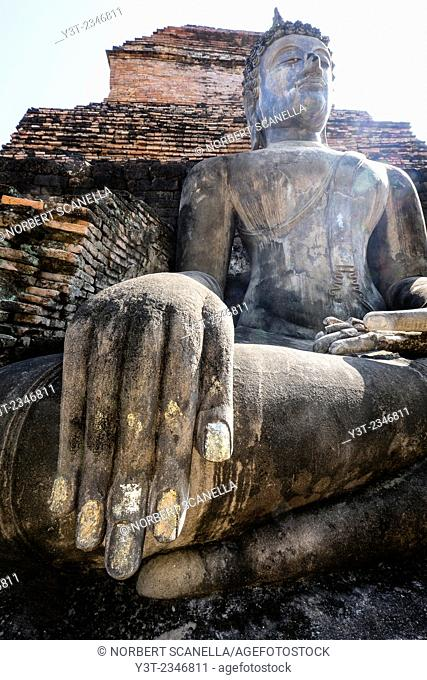 Asia. Thailand, old capital of Siam. Sukhothai archaeological Park, classified UNESCO World Heritage. Wat Mahatat. Buddha statue
