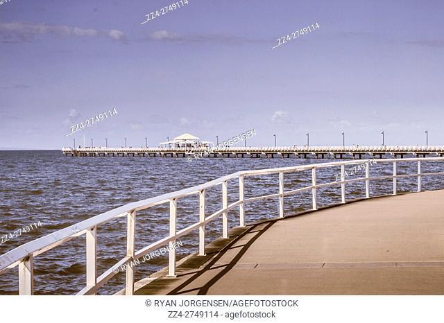 Outdoor old marine photo of pier landscape in light blues and purples. Taken Shorncliffe Pier, Queensland, Australia