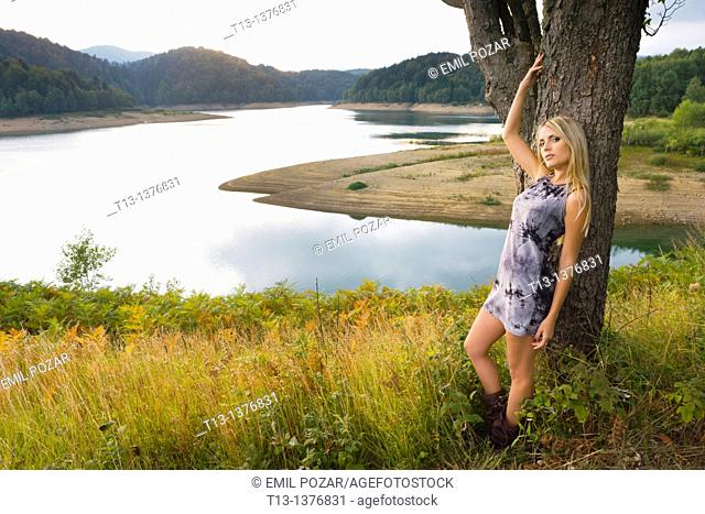 Attractive young woman in nature