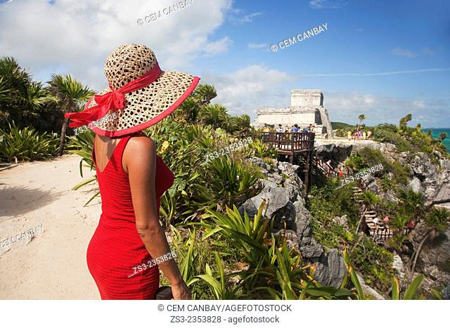 Woman posing at Tulum Ruins, Quintana Roo, Yucatan Province, Mexico, Central America