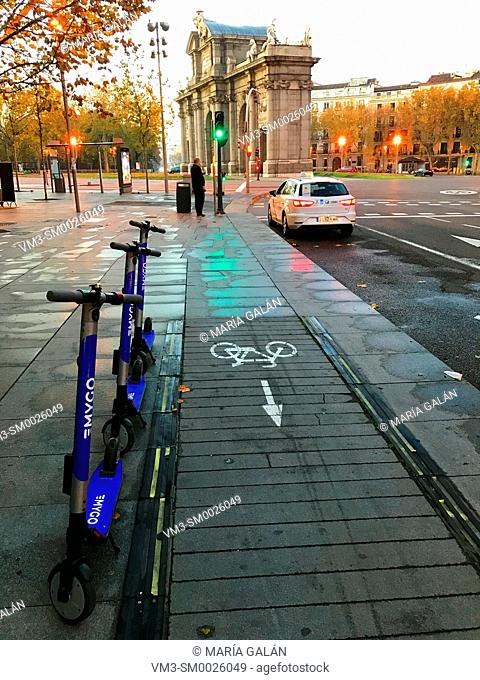 Electric scooters and cycle lane. Serrano street, Madrid, Spain