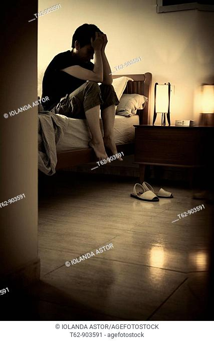 Times of crisis  Young woman thinks alone in his room  Color