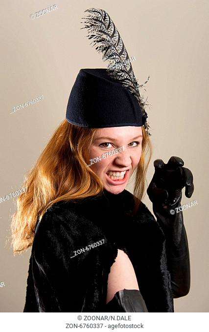 Redhead in black hat pretending to snarl