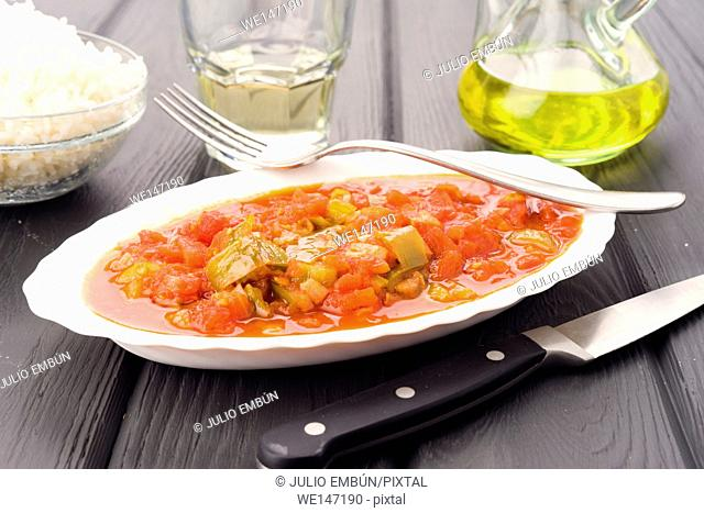 porcelain tray with ratatouille, on black wood