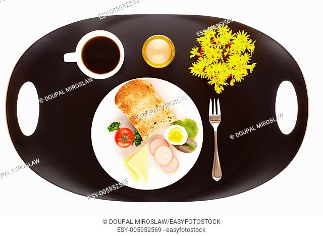 Breakfast with toast, cheese, sausage, salad, tomato, egg and cup of coffee
