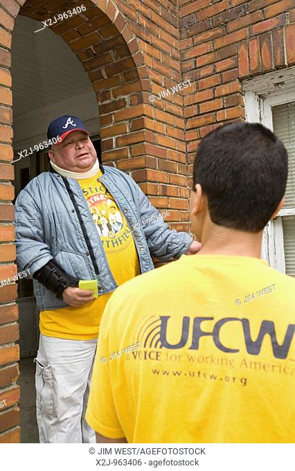 St  Pauls, North Carolina - Eduardo Pena, a union organizer from the United Food and Commercial Workers, visits Rafael Abrego, a Smithfield Packing worker