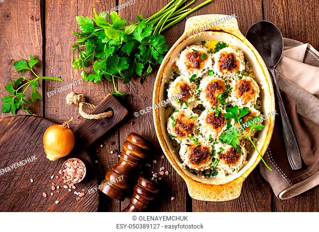 Meatballs baked in sour cream