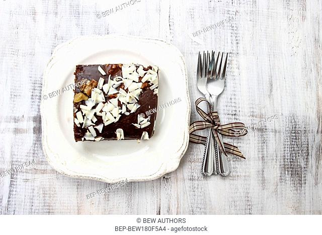 Top view of gingerbread cake with chocolate and hazelnuts. Selective focus