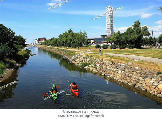 Sweden, Skane County, Malmo, sea kayaking along city canals and the Turning Torso tower by architect Santiago Calatrava in the background