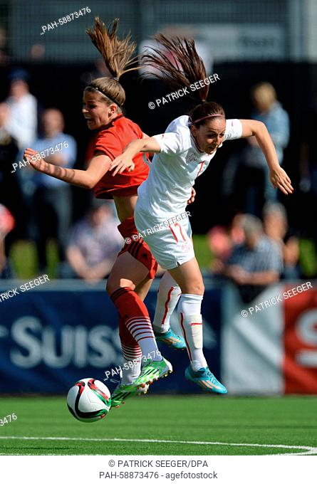 Switzerland's Martina Moser (R) and Melanie Leupolz (L) of Germany vie for the ball during the Women's international friendly soccer match between Switzerland...