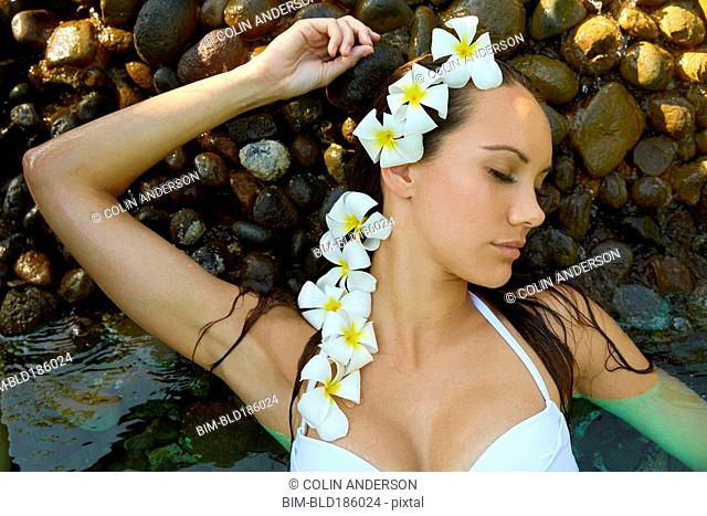 Pacific Islander woman with flowers in her hair