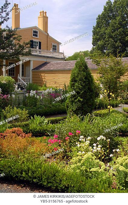 The backyard of the Longfellow House in Cambridge, Mass, has a lush garden