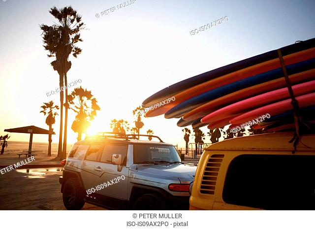 Multi-coloured surfboards tied onto vehicle, Venice Beach, Los Angeles, USA