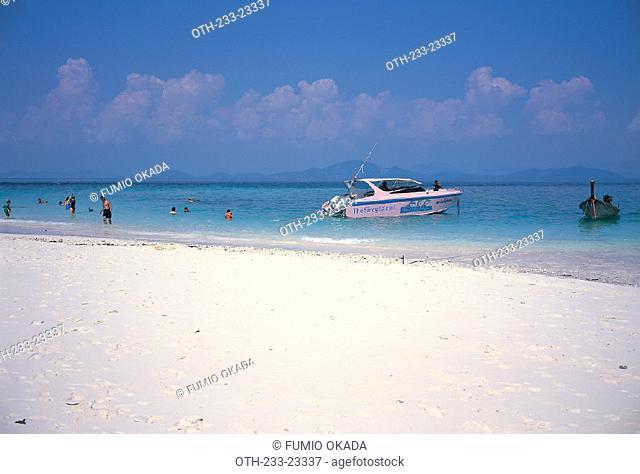 Swimmers at the beach of Khai Island, Thailand